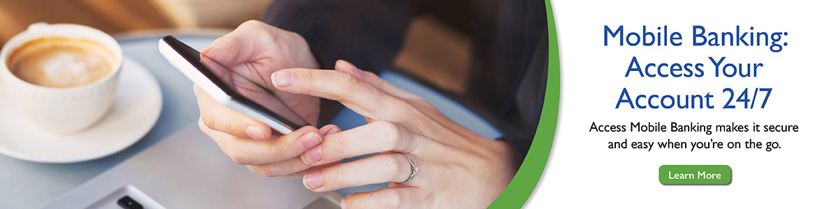 Image of a smartphone in person's hands, at table with coffee cup. Access your accounts 24/7 with Mobile Banking.